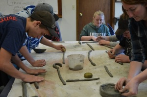 The humanities class working on coils and Native American pots