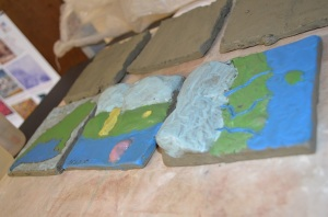 Tiles made representing glaciers, kettles, eskers, and other geological formations