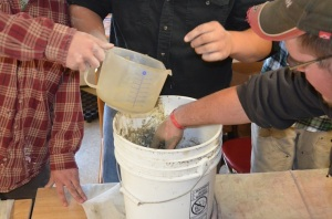 Mixing up our batch of clay gathered from campus