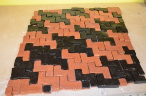 Tiles in a tessellating pattern using color to manipulate the plane