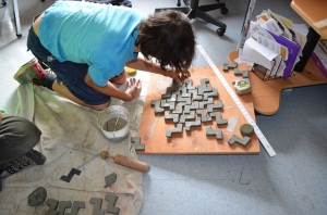 Cutting and arranging the hand made tiles